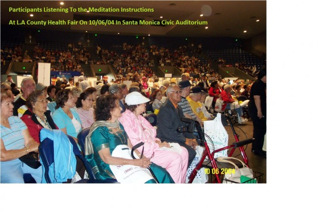 Participants Listening To the Meditation Instructions At L.A County Health Fair On 6th Oct, 2014 In Santa Monica Civic Auditorium, green letters
